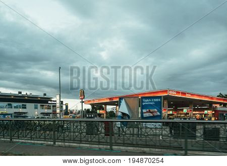 KEHL GERMANY - JUNE 30 2017: Esso petrol fuel station in Germany city - view from the car in motion. Esso is an American brand that is the American trade name for ExxonMobil and its related companies.