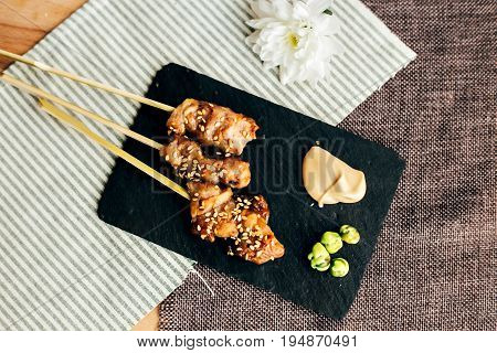 Amazingly tasty and mouth watering sticks tapas of teriyaki chicken as yakitori traditional japanese snack