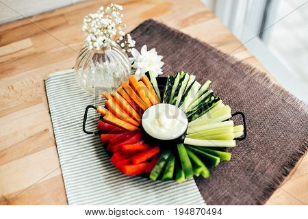 Variety of fresh healthy vegetables cut as a snack ready for greek yogurt salsa sauce dip