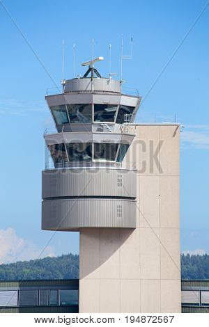 ZURICH - July 30:  Control tower of the Zurich Airport on July 30, 2016 in Zurich, Switzerland. Zurich airport is home port for Swiss Air and one of the european hubs.