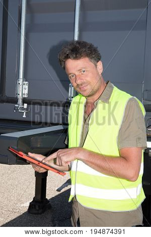 Businessman Using Tablet Pc And Selecting Supply Chain With Goods In Warehouse Process For Logistic