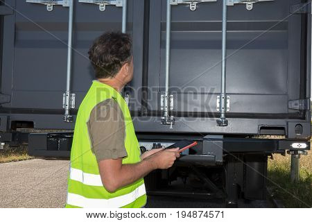 a Workers in Industrial Environment with yellow jaket