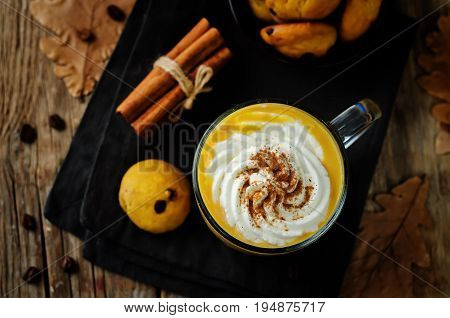 Pumpkin spice latte with whipped cream and pumpkin chocolate chips cookies