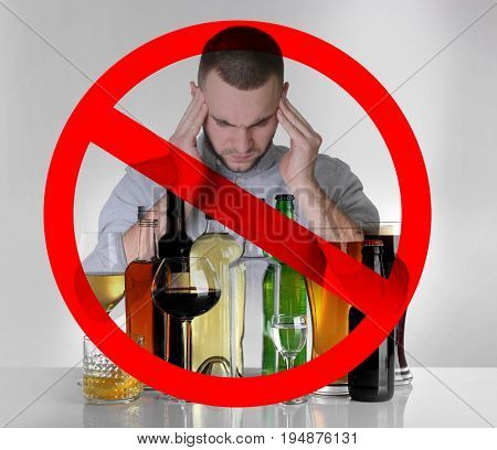 Collage of alcohol drinks in glassware, young man with headache and STOP sign on grey background