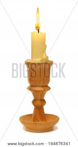 burning old candle vintage wooden candlestick. Isolated on a white background.