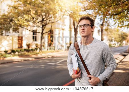 Handsome Young Man With Book Outside