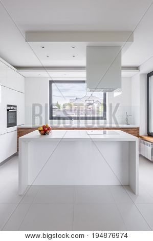 Stylish, White Kitchen With Island