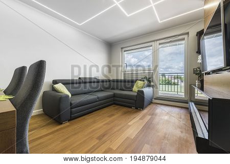 Modern living-room with wooden floor and led lights