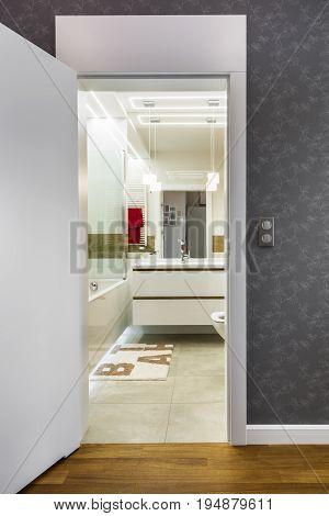 Open doors to modern bathroom interior design