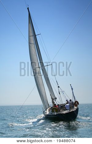 The large, beautiful yacht in the light-blue sea. A fresh wind and pleasant movement