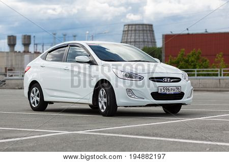 Ekaterinburg Russia July 03 2017 - Hyundai Solaris car (Accent) in a shopping center parking on a cloudy day