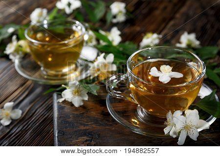 Jasmine tea with jasmine herb flower on