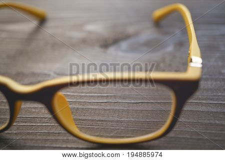 Macro Eyeglasses On Wooden Desk