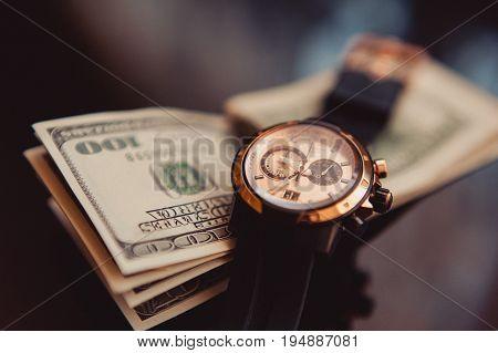 The watches and 100 dollars closeup at wedding