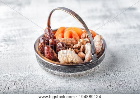 Mixture of dried fruits and nuts on a wooden surface