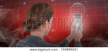Businesswoman using mobile phone against lines of blue matrix and codes