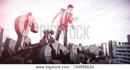 Businessman shouting through megaphone against city against blue sky