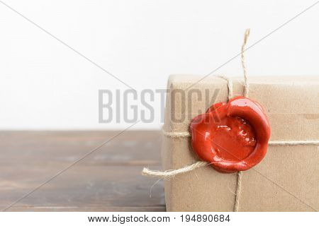 A Part Of Parcel Wrapped In Craft Paper With Rope And Red Sealing Wax