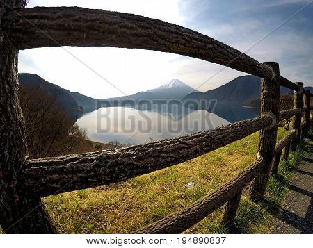 View of Mount Fujiyama through a wooden fence
