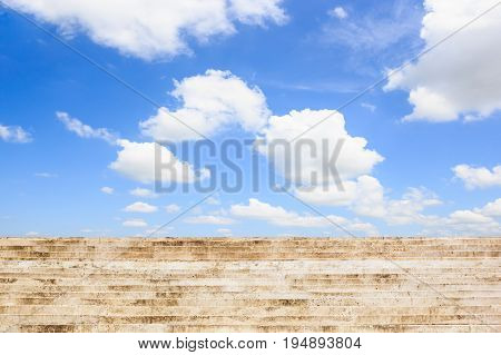 Old concrete stair with blue sky background.