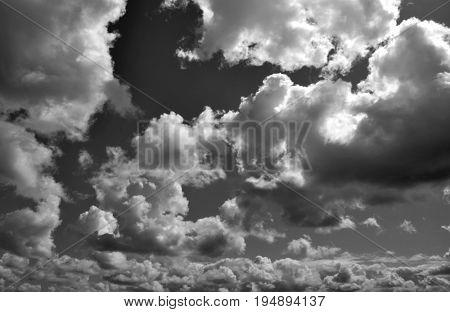 Black and white photo of dramatic clouds in blue sky