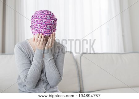 poor cancer woman feel bad at home