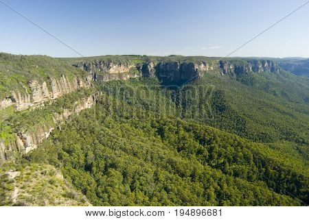 Scenic view of an escarpment in the Blue Mountains NSW Australia with forested slopes forming the Grose Valley