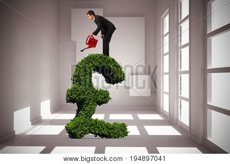 Businessman watering with red can against white room with squares at wall