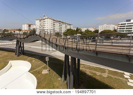 San Pedro de Alcantara Spain - June 1 2017: Wooden pedestrian bridge in the city of San Pedro de Alcantara. Malaga Province Andalusia Spain