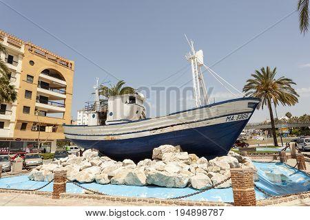 San Pedro de Alcantara Spain - June 1 2017: Old fishing boat in the city of San Pedro de Alcantara. Malaga Province Andalusia Spain
