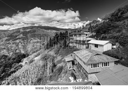 Okhrey village Himalayan mountain range in the background . Okhrey is a remote village with breathtaking scenic natural vista of world famous Himalayas in background in Sikkim India. Black and white image
