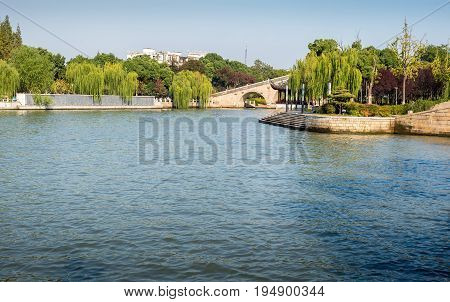 Suzhou, China - Nov 5, 2016: View of the Waicheng River as viewed from a nearby public park. A serene scene.