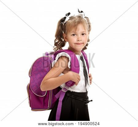 Portrait of beautiful little smiling schoolgirl wearing knapsack