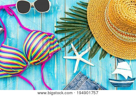 Summer Fashion woman swimsuit Bikini. Tropical sea.Unusual top view colorful background. Summer Concept.