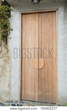 Vintage closed wooden door of house stock photo