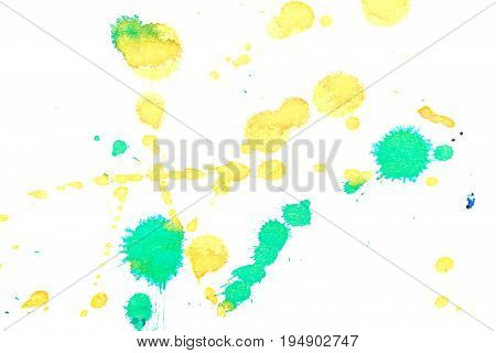 Abstract two-color yellow green ink splash. Ink blots. Elements of design. The water-soluble ink on white paper Leste. Abstract art