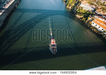 View of Douro river from Dom Luis I bridge with shadow on the water, Porto, Portugal.