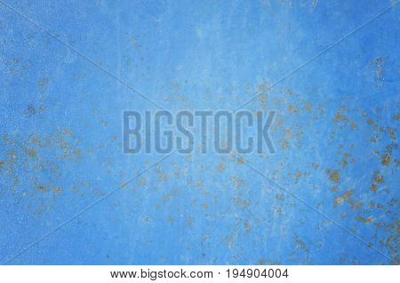 rust on blue steel background or rusted metal texture