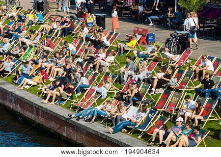 BERLIN - JULY 09 2017: Cafe on the embankment Spree. Resting place visitors and residents of Berlin.