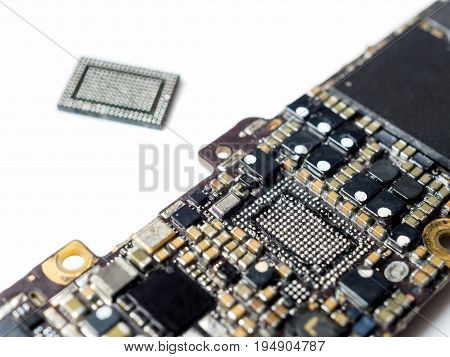 Close-up image of smartphone logic board removed power IC on white background