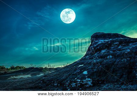Landscape Of Rock Against Sky And Full Moon Above Wilderness Area In Forest. Cross Process.