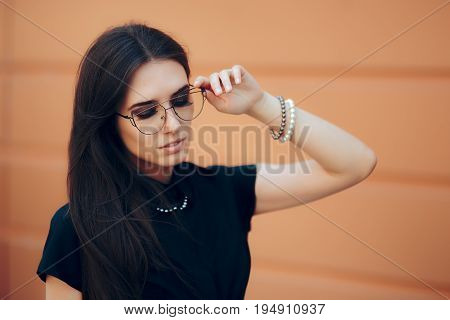Elegant Fashion Woman with Trendy Eyeglasses and Pearl Accessories