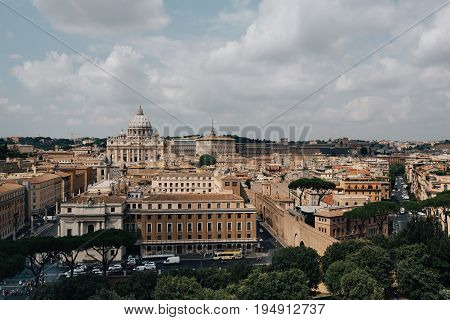 Rome Italy - August 18 2016: View of Rome from Castel Sant Angelo. Vatican city on background a cloudy day of summer