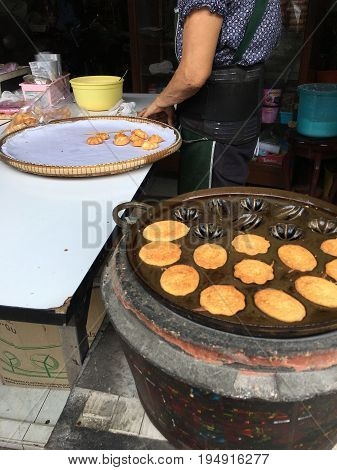 Madeleines Cookies, Egg Candy Box Or Egg Cakes Or Madeleines. Hand Of Merchant Cooking In A Hot Pan