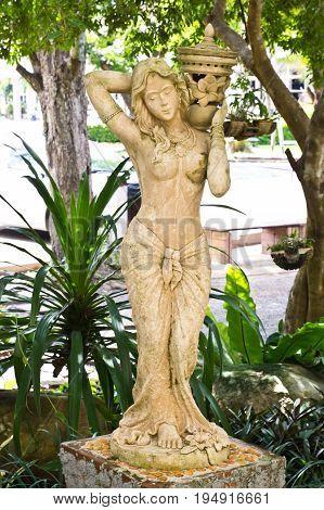 sandstone statue of woman in garden, spa decoration
