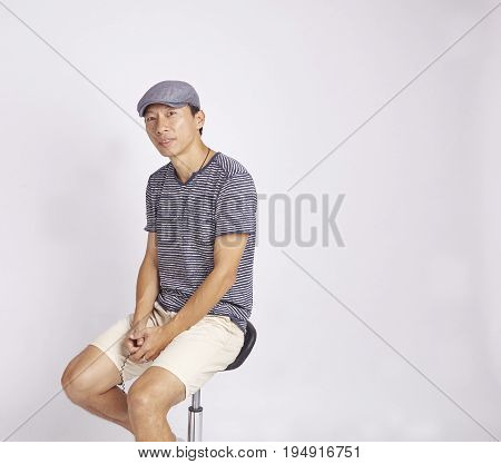 Mature Asian Designer Smiling At Camera Isolated On White