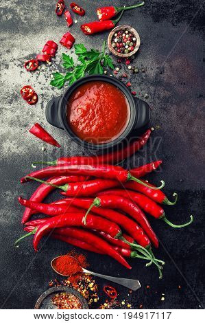 Chili sauce and fresh peppers, chilli ketchup