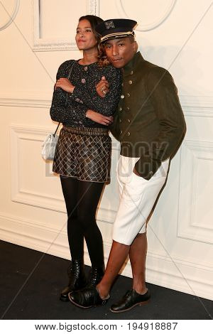 NEW YORK-MAR 31: Pharrell Williams (R) and wife Helen Lasichan attend the CHANEL Paris-Salzburg 2014/15 Metiers d'Art Show and Party at the Park Avenue Armory on March 31, 2015 in New York City.