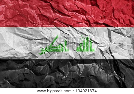 Iraq flag painted on crumpled paper background