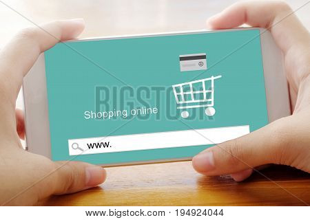 Hand holding smart phone with www. on search bar screen background on line shopping business E-commerce technology and digital